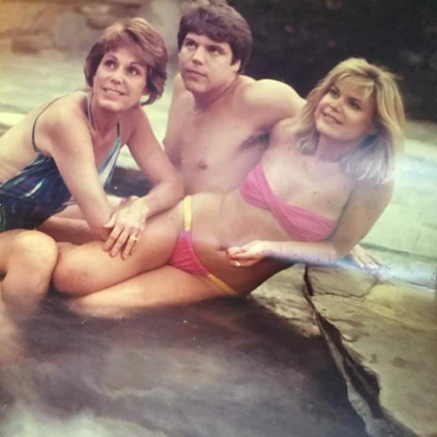 Travis with his mom and sister