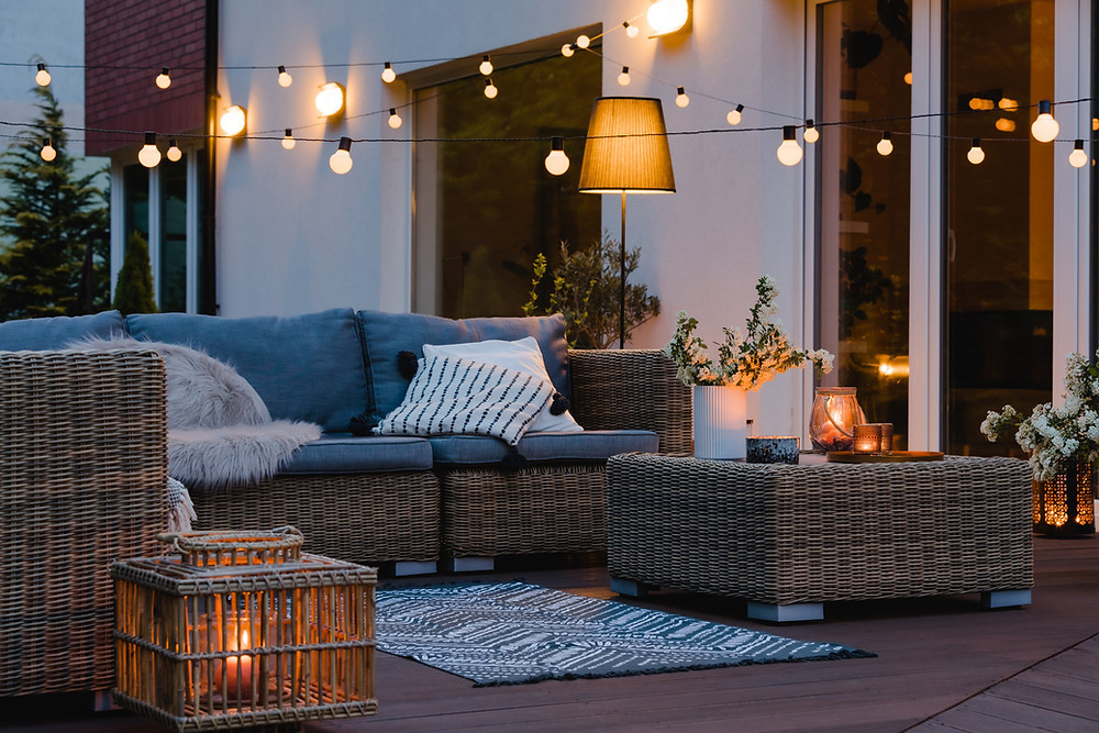 Carol-Lang-Interiors_Fair-Haven-New-Jersey_How-to-Design-a-Safe-Social-and-Serene-Outdoor-Living-Space_Stone-Fireplace-with-Coffee-Table-and-Seating