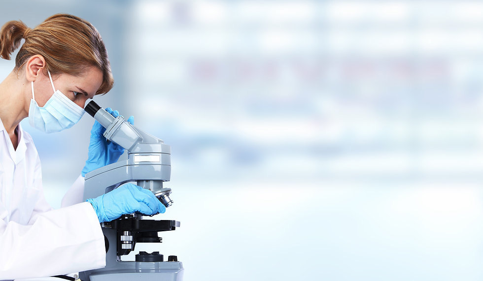 Doctor woman with microscope in laboratory. Scientific research..jpg