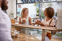 female-friends-having-coffee-PE2WQ4N.jpg