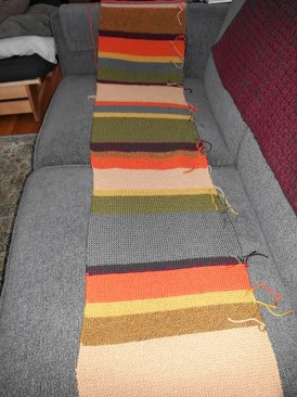Half of the mixed source Doctor Who scarf layed out