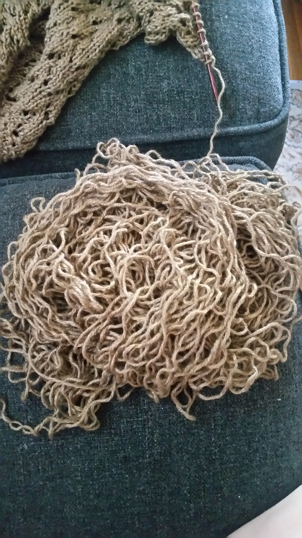 the pile of yarn at the end of the unraveling