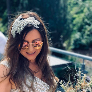 Summer bride with bespoke peacock feathe