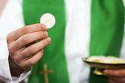 priest-holding-Communion-host.jpg