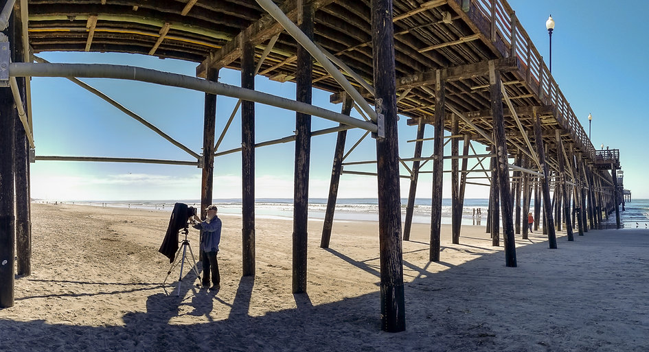 Will Gibson photographing at the Oceanside CA Pier Photo by Kurt Lightfoot©2020
