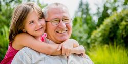bigstock-Happy-grandfather-with-grandch-40973077
