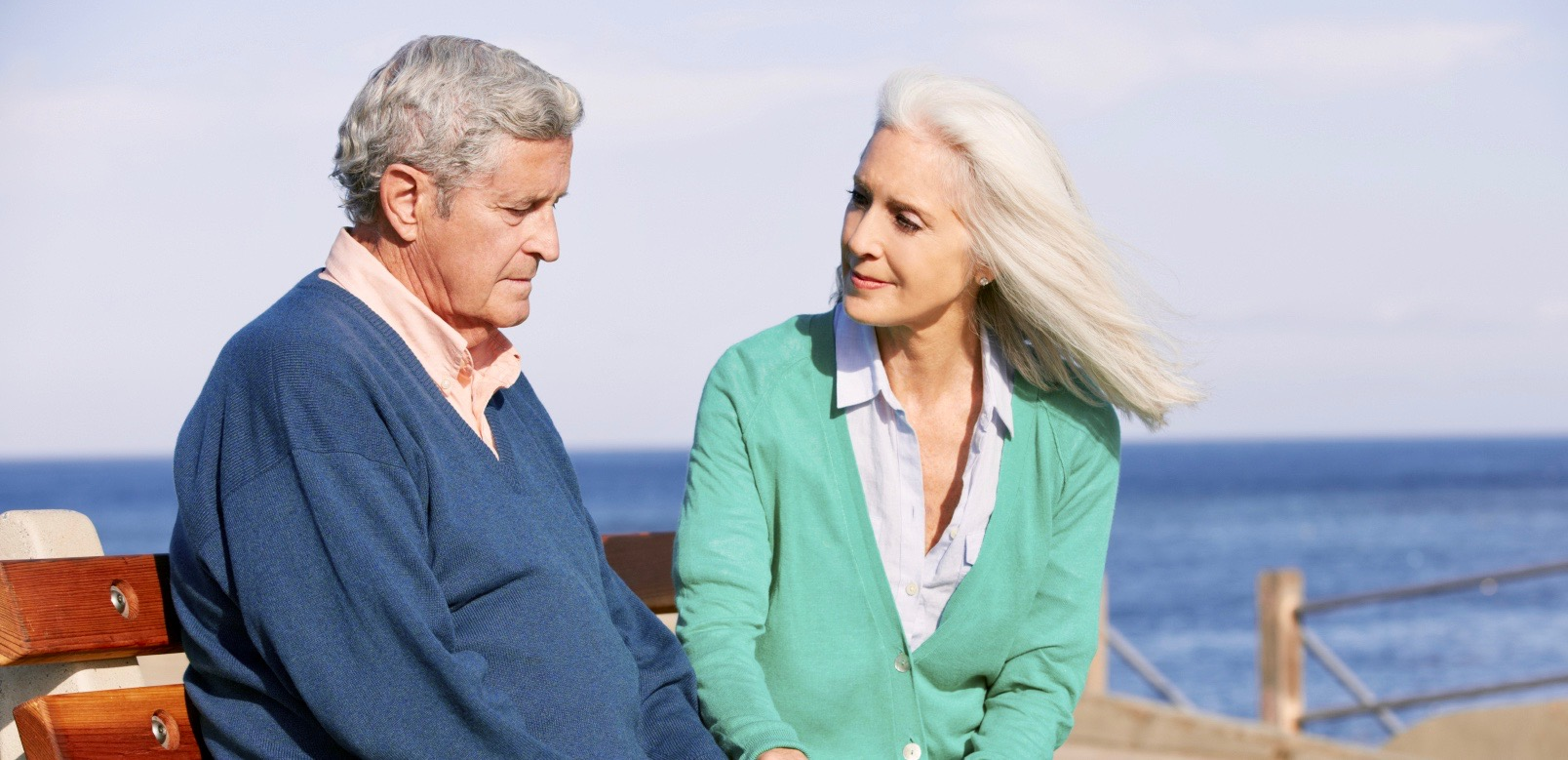 Older_man_with_woman_on_beach_LBD