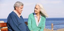 Older_man_with_woman_on_beach_LBD