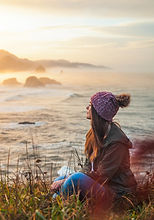 woman-sitting-by-the-cliff-1720001.jpg