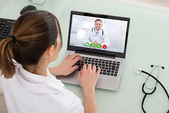 Young Female Doctor Video Chatting On La