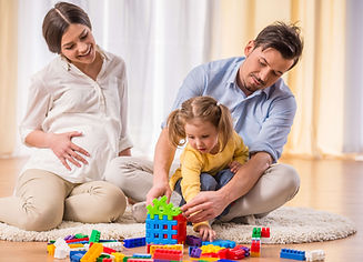 Pregnant mother and father doing PCIT Special Time with their young daughter.jpg