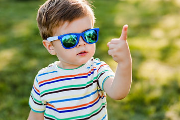 Boy in sunglasses showing number 1 to represent Step 1 of PCIT Certification Training