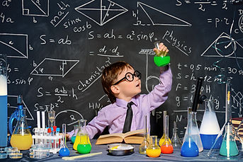 Child in a shirt and tie pretending to be scientist.  The picture is used to highlight that PCIT is an evidence-based practice.