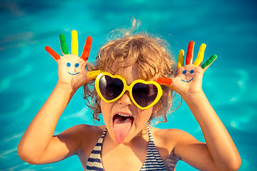 Girl in sunglasses making a funny face and showing her hands to represent Step 5 of PCIT Certification Training