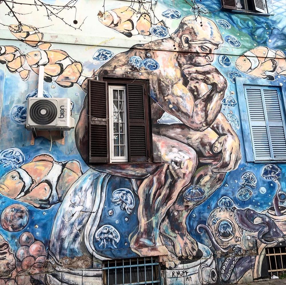 The Submarine Thinker street art by Carlos Atoche