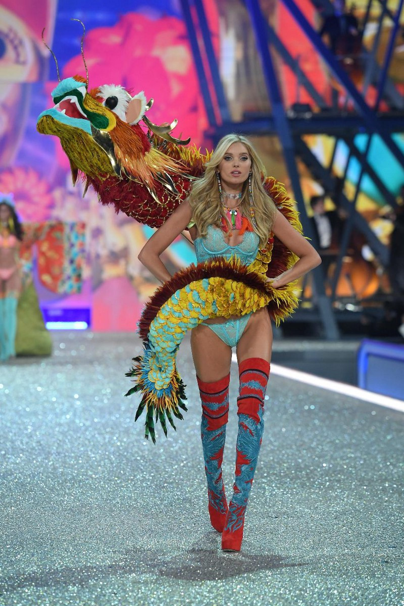 Elsa Hosk in the 春節 festive dragon. Photo by Dimitrios Kambouris/Getty Images for Victoria's Secret via Forbes.com