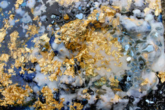detailed shot of blue and gold encaustic painting