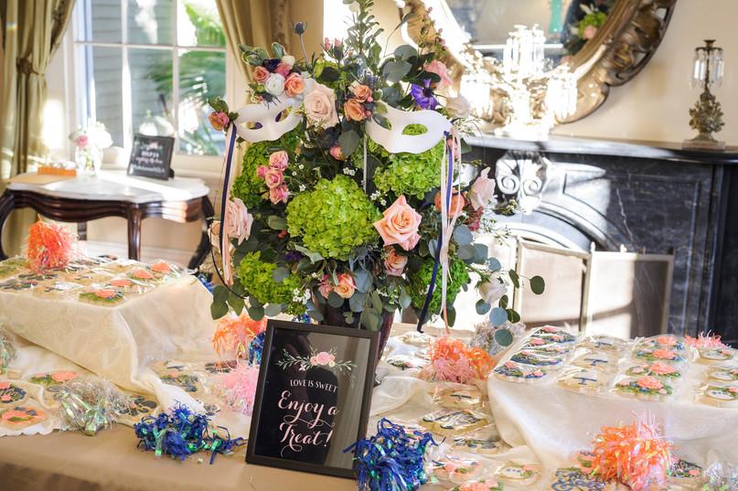 Kristina & Garrett Wedding Centerpiece with Mardi Gras Masks