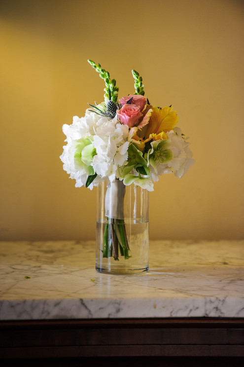 Small toss bouquet of Hydrangea, snapdragon, helebore, and peach roses, vintage New Orleans, Louisiana destination wedding at the Benachi House. Floral Design by florist, Michelle Pierce for The Sentimental Petal Baton Rouge, Louisiana. Photo by Eye Wander Photography, 2018.