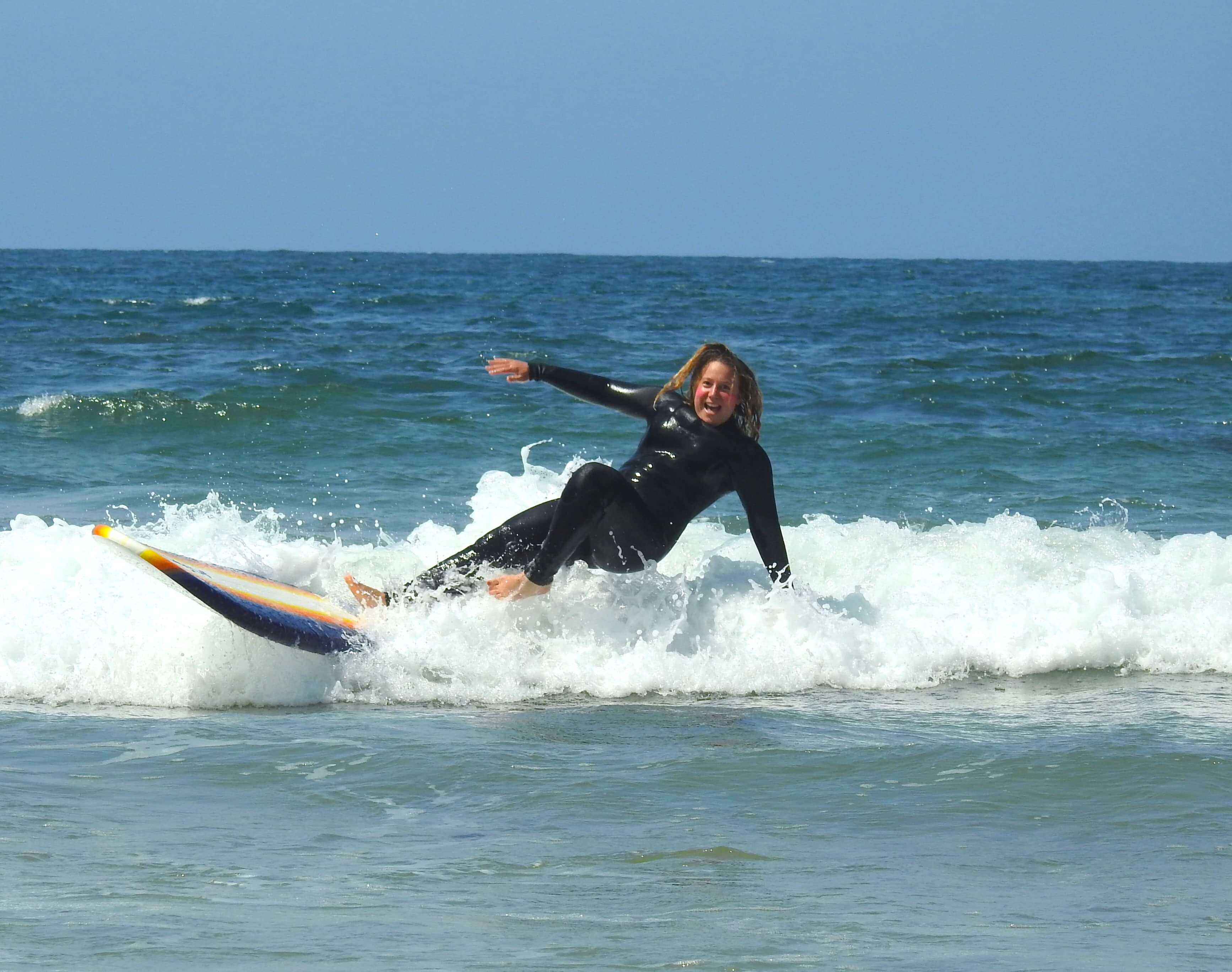 Girl learning to surf Torquay