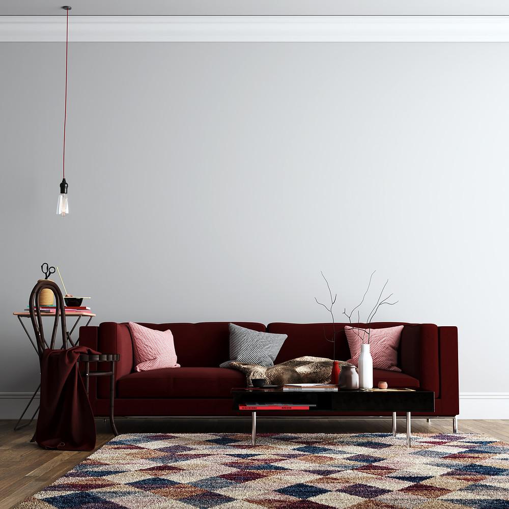 Image of beautiful burgundy velvet sofa in a living room.