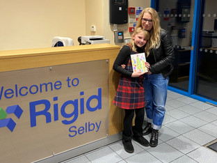 Rigid Containers celebrates charity advent calendar competition winner