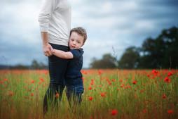 son-hugging-mother-poppy-field-Jo-temple