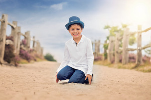 boy-sitting-sand-hat-jo-temple-photograp