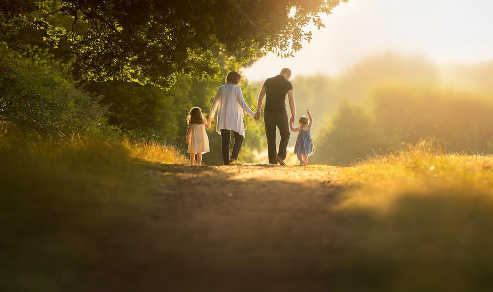 family-walking-away-morning-summer-sunli