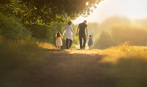 family-walking-away-morning-summer-sunli