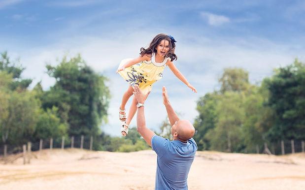 dad-throwing-daughter-in-air.jpg