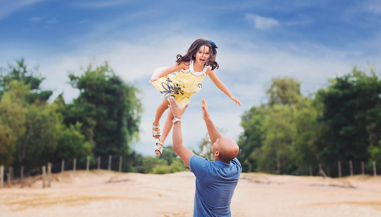 daughter-father-throw-summer.jpg