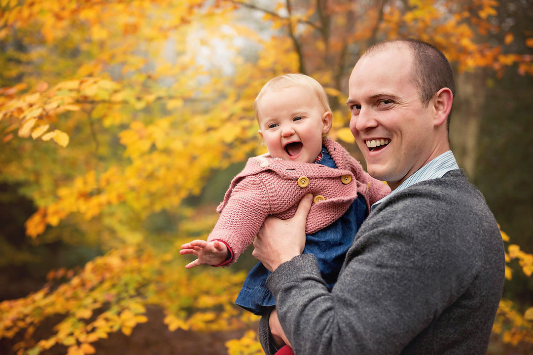 autumn-father-baby-laughing-yellow-tree.jpg