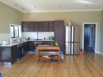 Relocated and updated kitchen including floors and walls