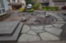 Landscape construction of flagstone path and basalt boulders