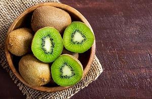 kiwi-fruit-on-wooden-background-260nw-54