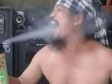 Indonesian Man Who Sprays Insecticide Into His Mouth While Dancing Topless Dies
