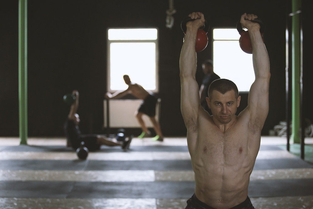 a man performing kettlebell and cardiovascular exercises
