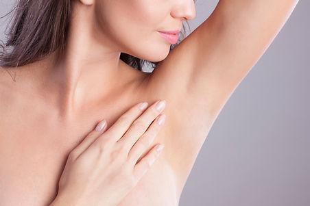 Close up of female armpit. Model touchin