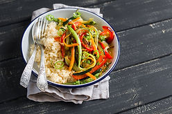 rice with vegetables on a plate light on