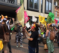 Extinction Rebellion groups from Surrey march through Kingston after Surrey County Council declare a climate emergency and state intention for Surrey to become carbon neutral by 2050, which is too slow to save the lives of millions of people in the global south from climate breakdown