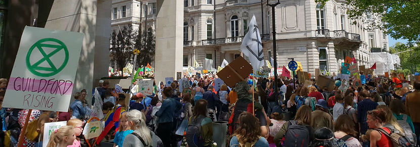 Large scale civil disobedience by Extinction Rebellion during an internatioal mother's day march against government inaction on th climate crisis