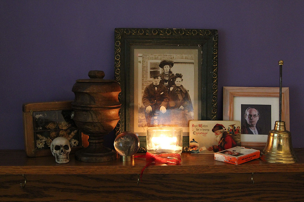 Picture of a mantlepiece with strange and spooky objects