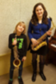 Julia Maloof teaching young beginner saxophonist