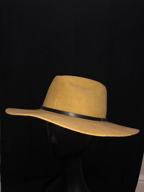 9a8f1d8e4fc1f Handcrafted felt mustard fedora with thin brown leather strap detail. A  fedora and mustard are  must haves  for this season.