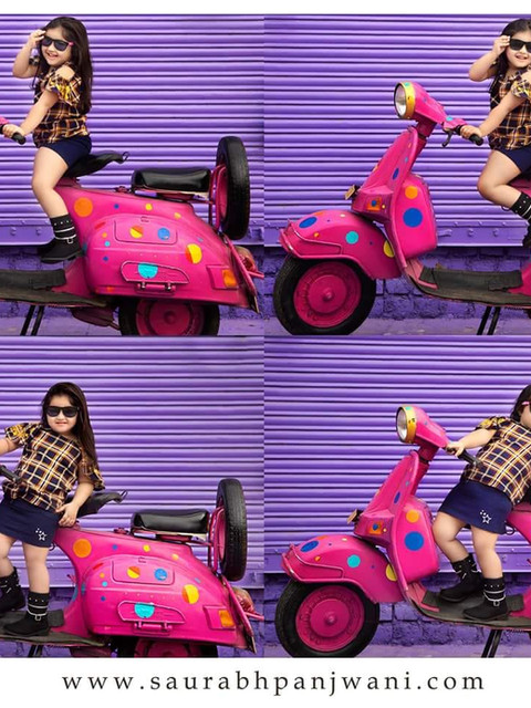 Kid Shoot at Purple Wall and Pink Scooter