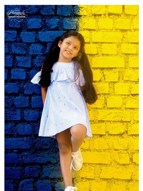 Kid Shoot at Yellow and Blue Wall