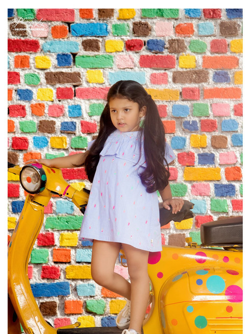 Kid Shoot at Colourfull Wall