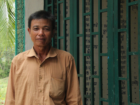 Former monk Tes Ding is a caretaker at a local pagoda, surrounded by paddy fields used as mass graves by the Khmer Rouge. He is raising money to extend the prayer area of the pagoda, so that the former foes can pray together.