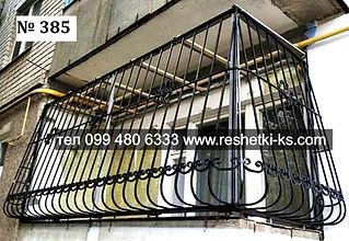 Металлическая решетка с коваными элементами на балкон